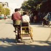 I snapped this shot while riding in a similar bicycle taxi.