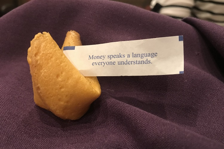 Fortune cookie on purple napkin that says