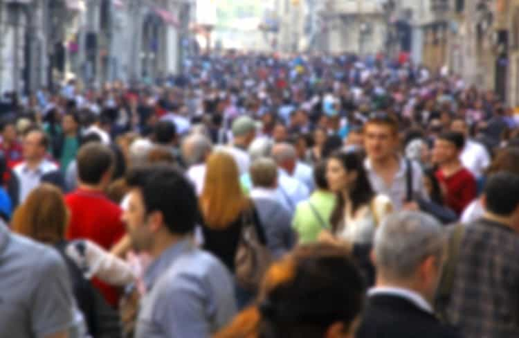 Blurry view of a crowd of people, a visual metaphor of real estate crowdfunding investing. This real estate crowdfunding investing comparison guide is a starting point for understanding the different types of platforms and investments available.