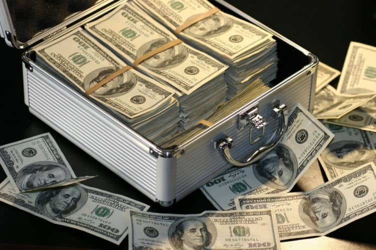 Picture of metal box with $100 bills. How much money is enough to retire or change careers? As my wealth has increased, I've found that net worth is an imperfect measure of enough.