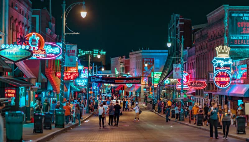 Night photo of Beale Street in Memphis, where the author owns out-of-state rental properties.